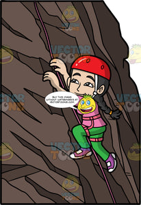A Woman Climbing Up A Rock Wall. A woman with dark hair tied back in a braid, wearing green pants, a pink shirt, purple rock climbing shoes, and a red helmet, climbing up a rock wall with the aide of a pink rope