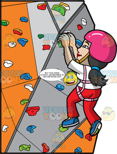 An Asian Woman Indoor Rock Climbing. An Asian woman with black hair tied in a low pony tail, wearing red pants, a white shirt, blue shoes, and a pink helmet, using her hands to pull herself up an indoor rock wall