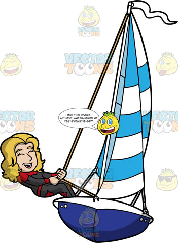 An Adventurous Woman Sailing A Boat. A woman with blonde hair, wearing a red and black wetsuit, leans back while pulling the rope of the striped white and blue sail of her dark blue with white sailboat that has a white flag