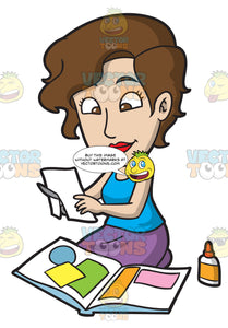 A Woman Cutting Colored Paper Sheet For Scrapbooking