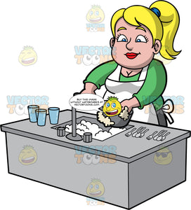 Pat Washing Up After Dinner. A chubby blonde woman wearing a green shirt and a white apron, standing at the kitchen sink washing a dirty saucepan