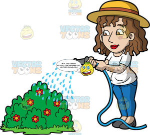 A woman watering a flowering bush. A woman with brown hair and eyes, wearing blue pants, a white t-shirt, gray shoes and a sun hat, using a hose to water a bush filled with red flowers