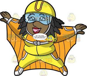 Lisa Wingsuit Flying. A black woman wearing an orange and yellow wingsuit, a yellow helmet, and clear goggles, smiles as she flies through the sky in her wingsuit