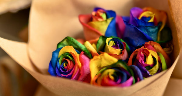 What is a Rainbow Rose and what is its meaning?