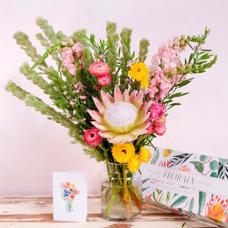 Bright and beautiful flower bouquet with king protea, snap dragons and paper daisies.