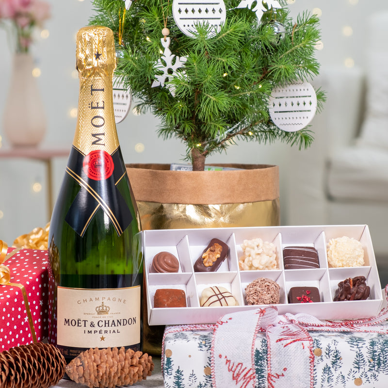 Champagne, Christmas tree and chocolates