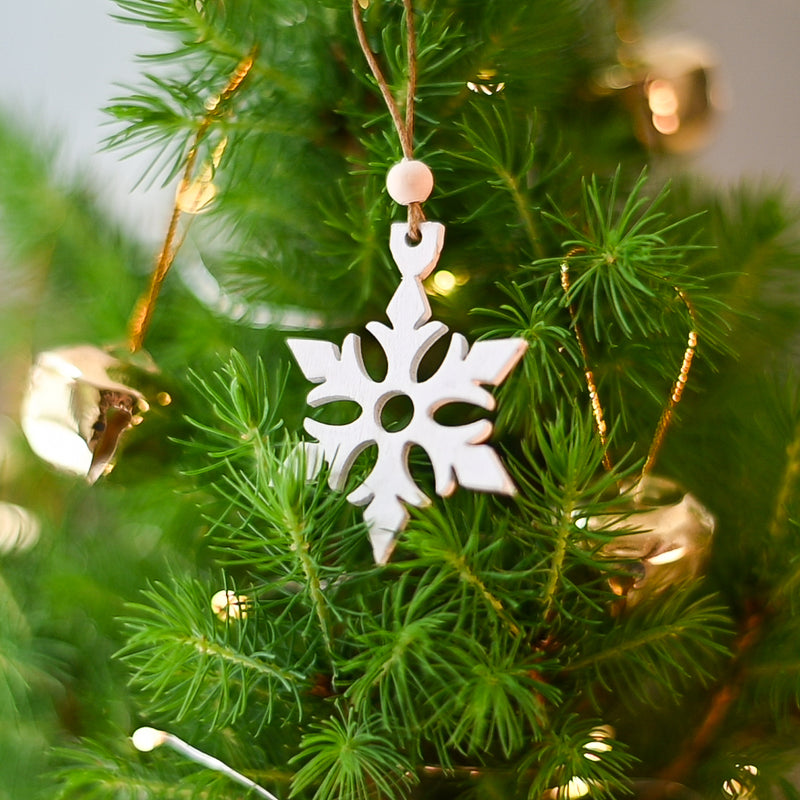 White wooden star on a Christmas tree