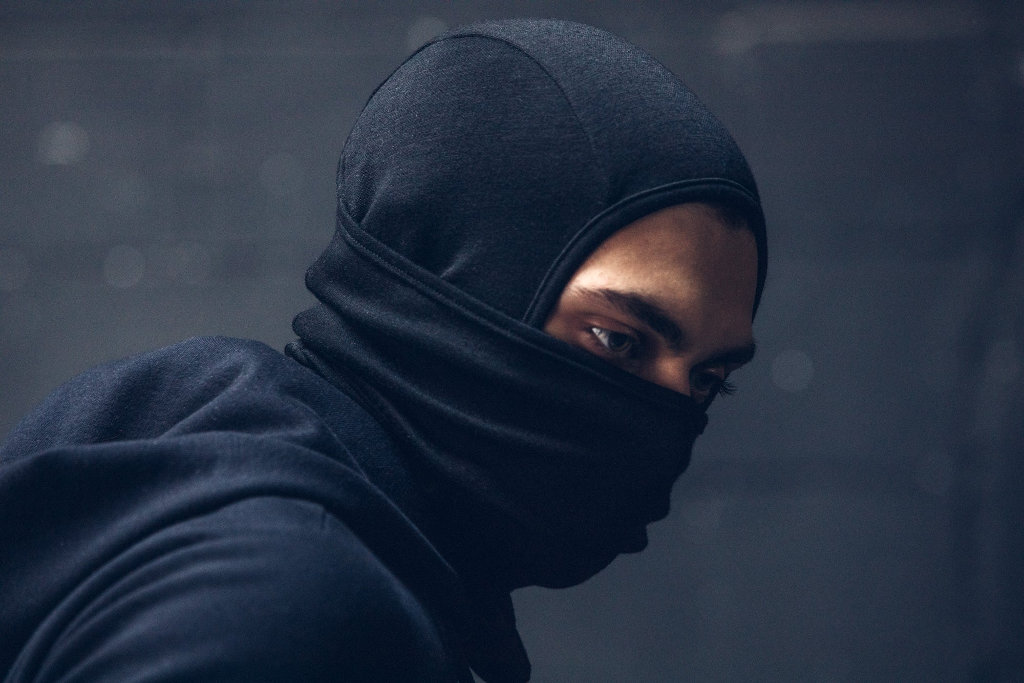 Kiril wearing the Doublefine Merino Balaclava while looking down.