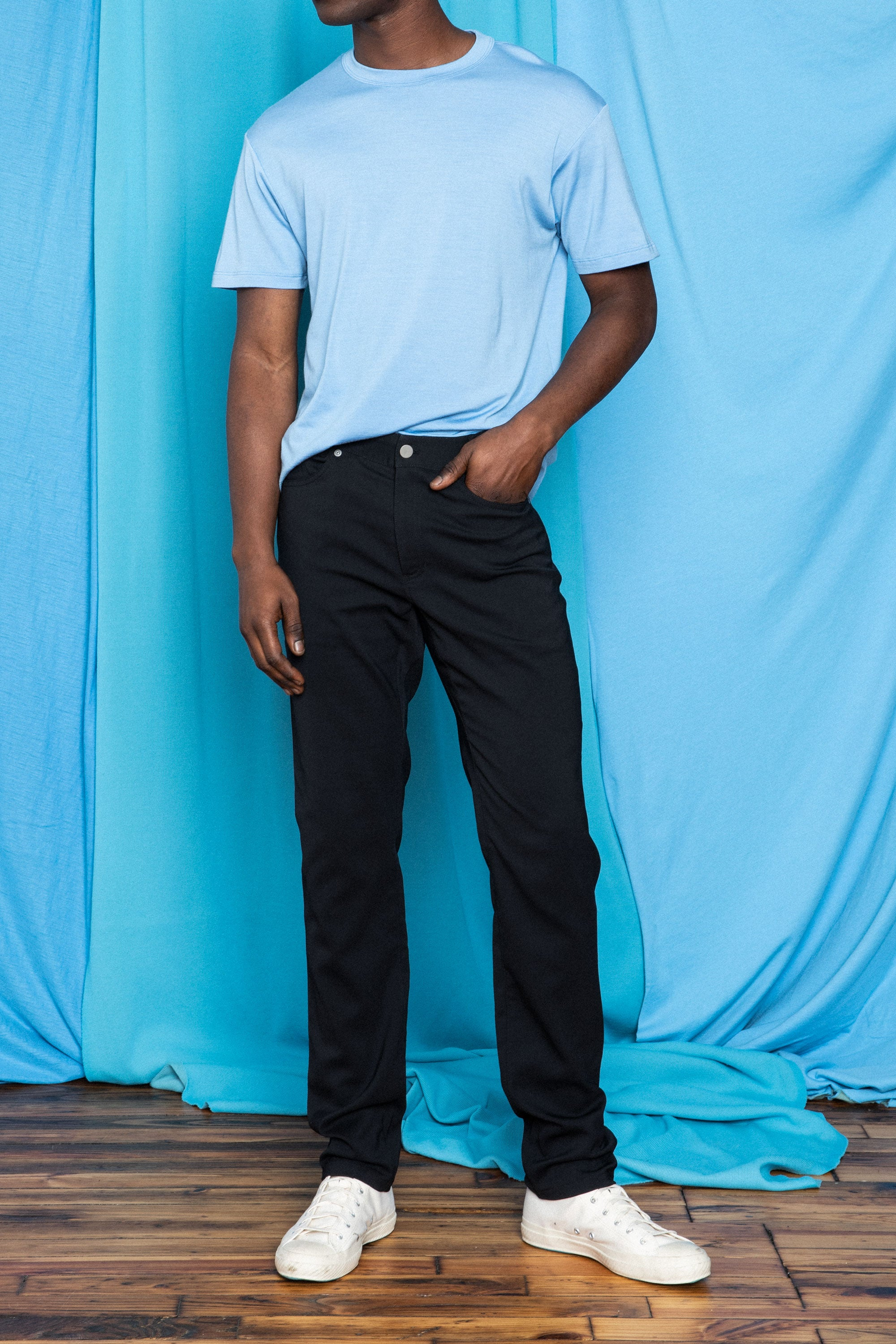 Torey in the Ultrafine Merino Cut Two T-Shirt in High Blue and the Strong Dungarees in Black, front view