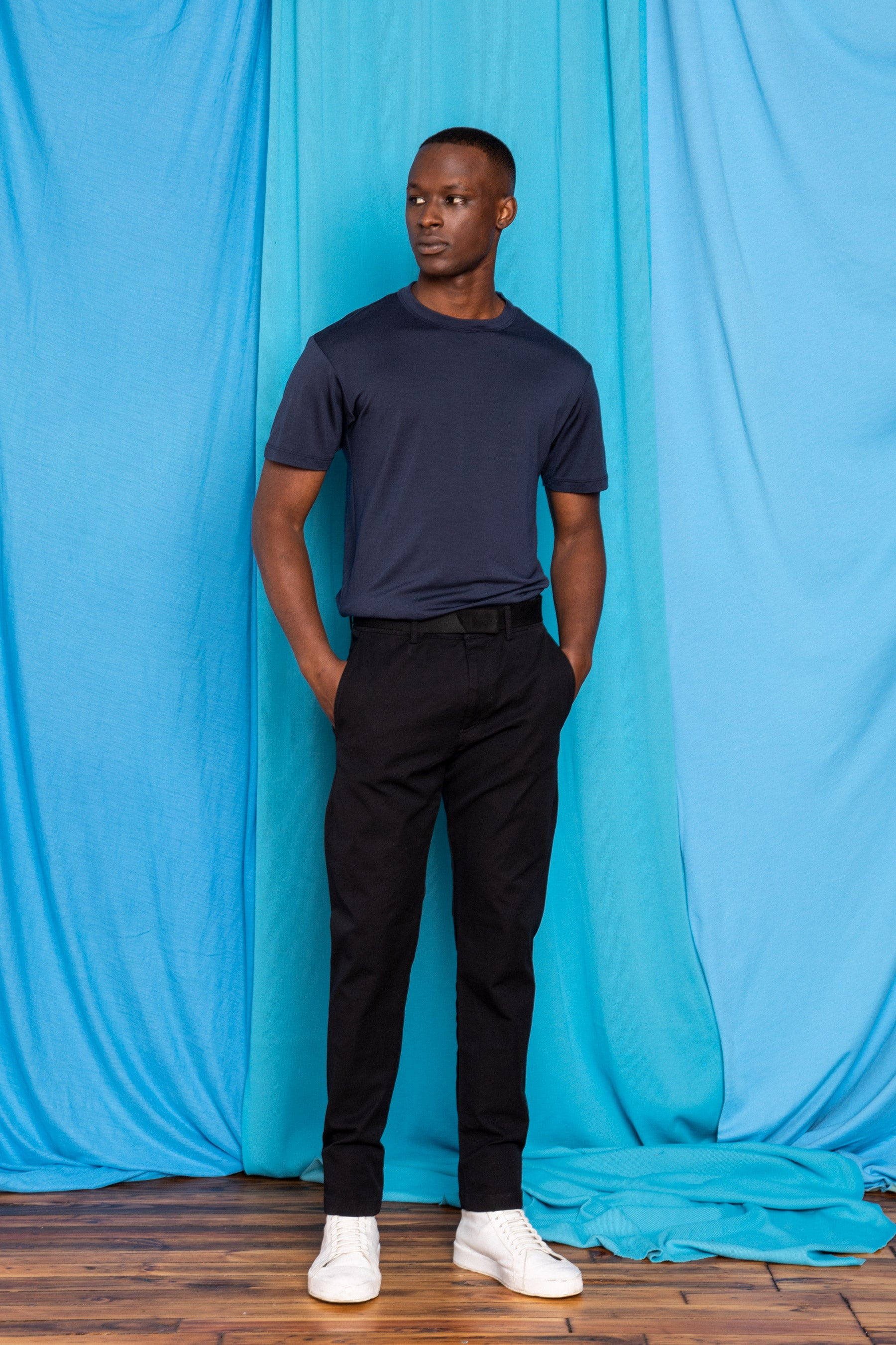 Torey in the Black Free/Co Darts, Navy Ultrafine Merino Cut Two T-Shirt, and Polyamour Belt, front view