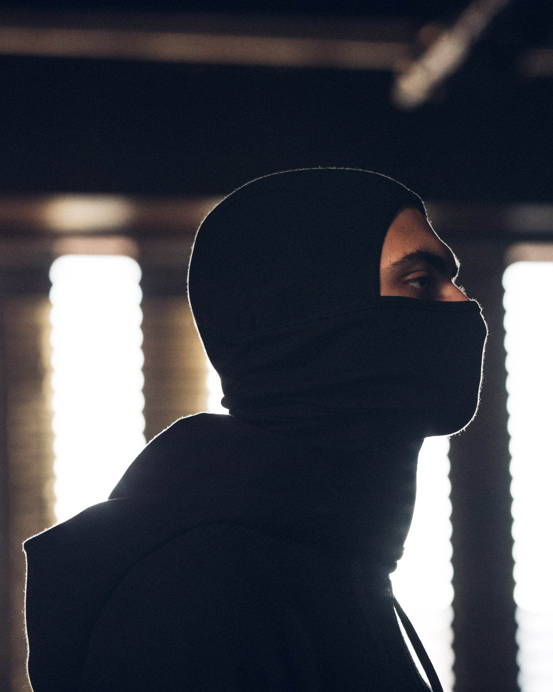 Side profile of Kiril wearing the Doublefine Merino Balaclava.