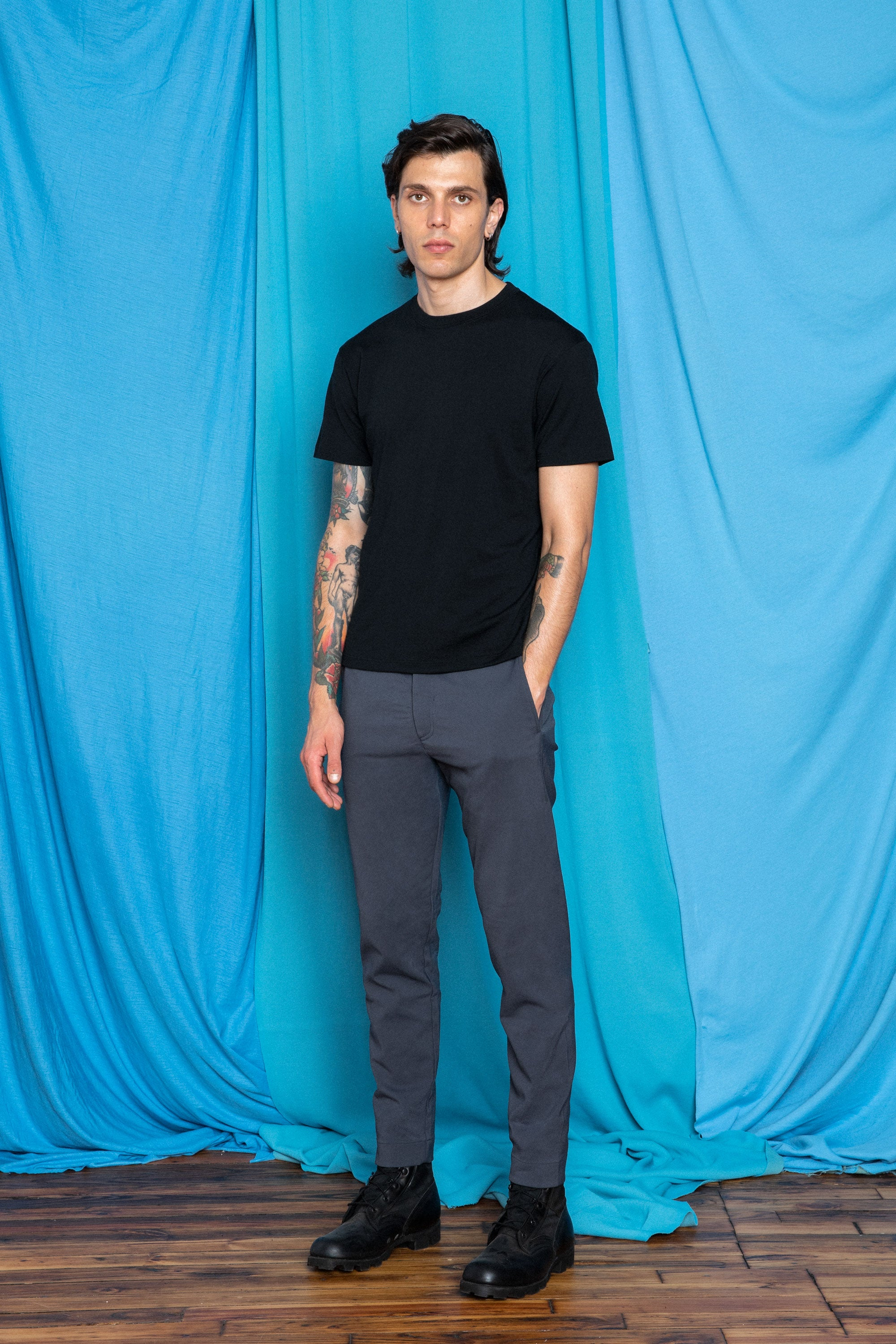 Daniele in the Bluetint Gray Workdarts and a Black Ultrafine Merino Cut Two T-Shirt , front view