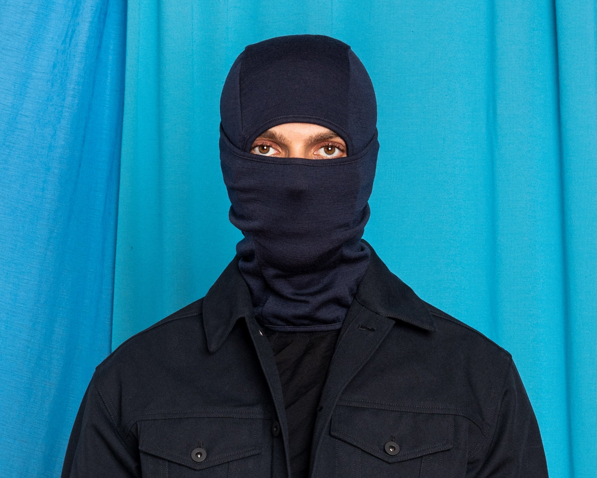 Daniele wearing the Doublefine Merino Balaclava in Black Navy.