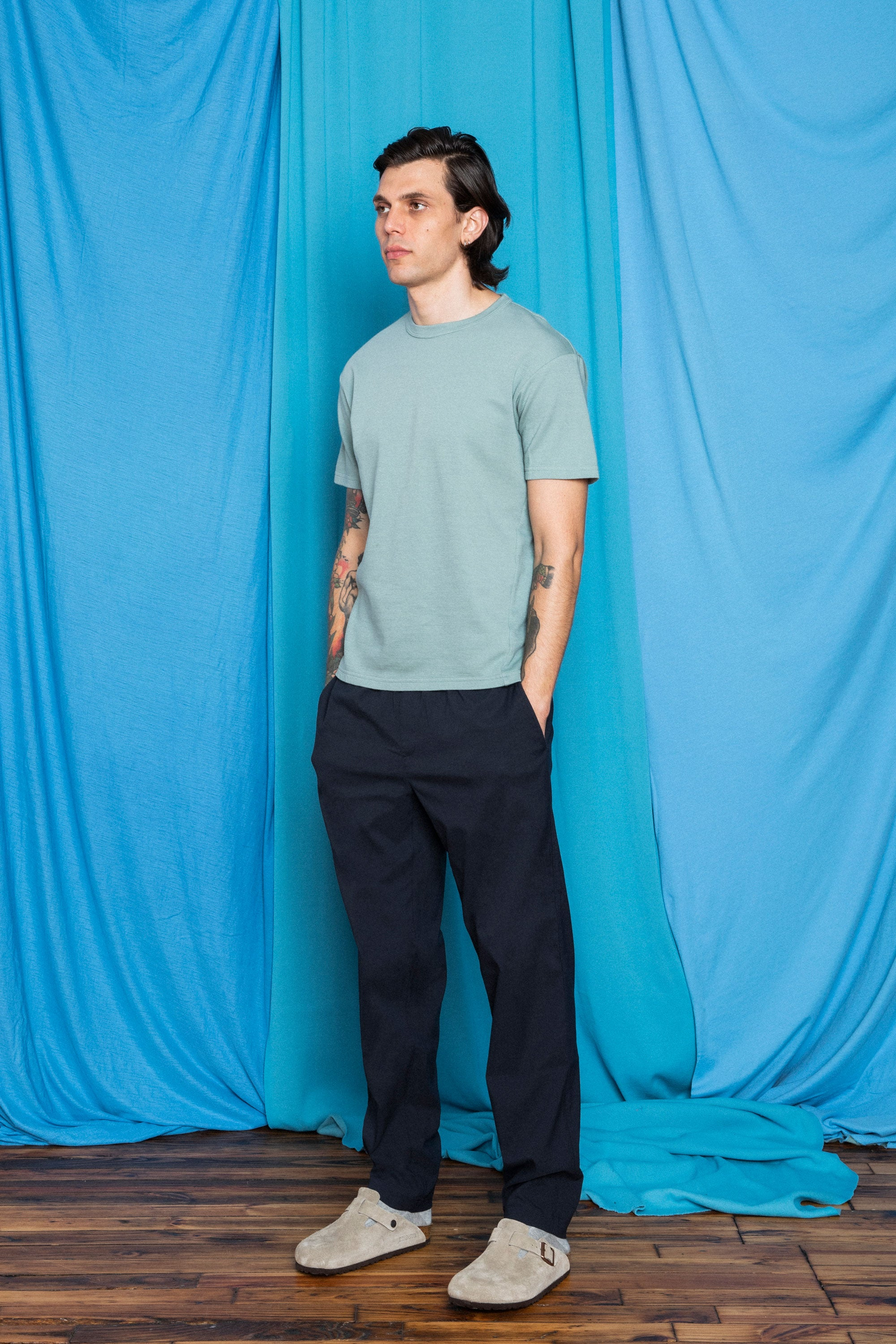 Daniele in the Dark Navy F.Cloth Yes Pants and Sage Cottonweight Cut Two T-Shirt, 3/4 view