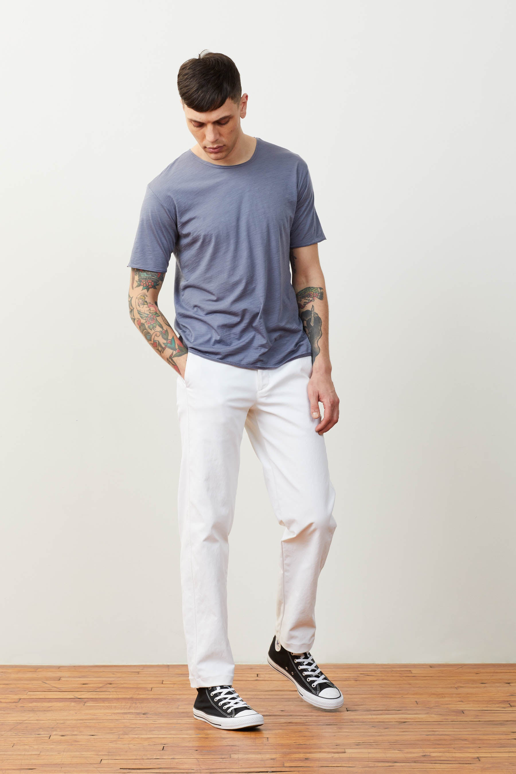 Full fit image of Daniele wearing the Bombworks in White with a Dreamweight Rawcut Shortsleeve in Dreamgray