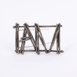 DM198B: I AM burnt matchstick brooch