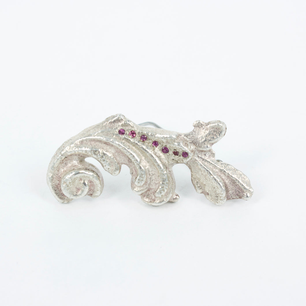 VM120: Sand cast scroll brooch