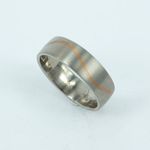 TD28: Gold wave inlay titanium ring
