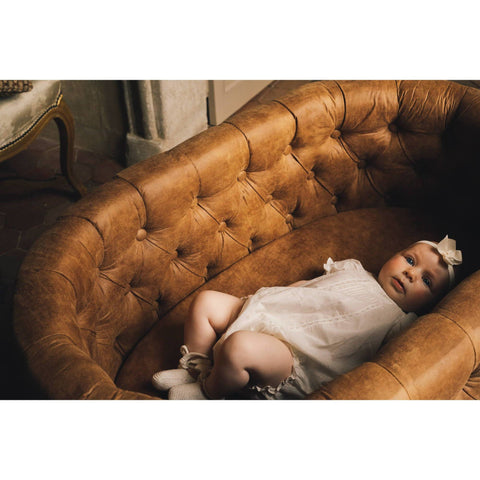 Image of Bassinet - Aristot Bassinet Tufted Faux Leather + Rondo Gold Base