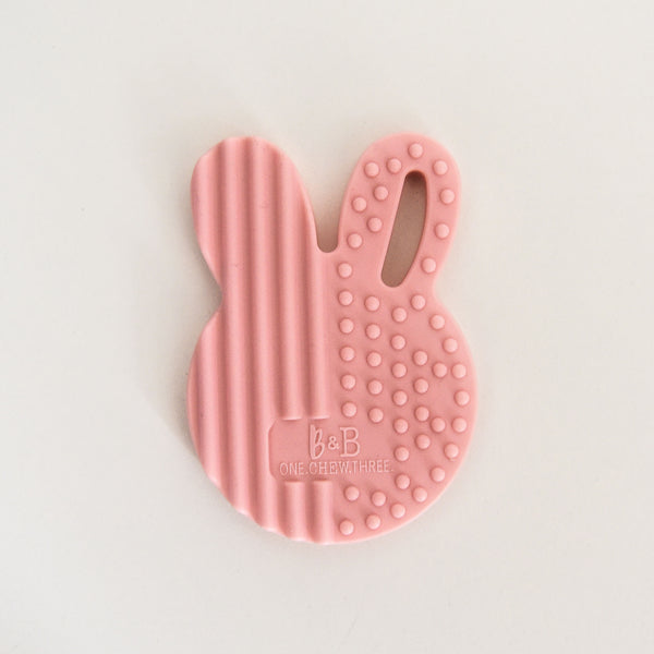 This fairly floss pink, rabbit head shaped baby teether is a great gift for new mums. With a smooth back and a textured front it is perfect for little gums.