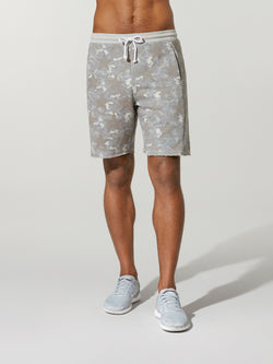 front view of shirtless male model in light grey camouflage printed shorts