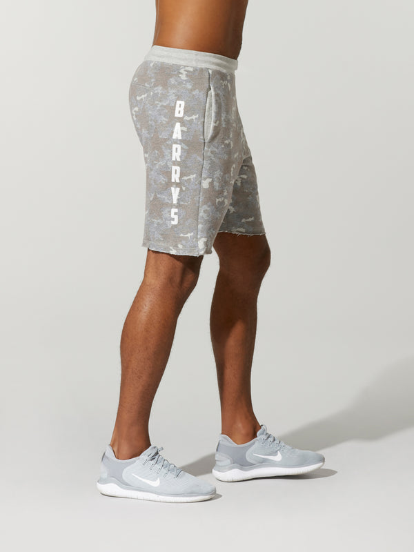 side view of shirtless male model in light grey camouflage printed shorts