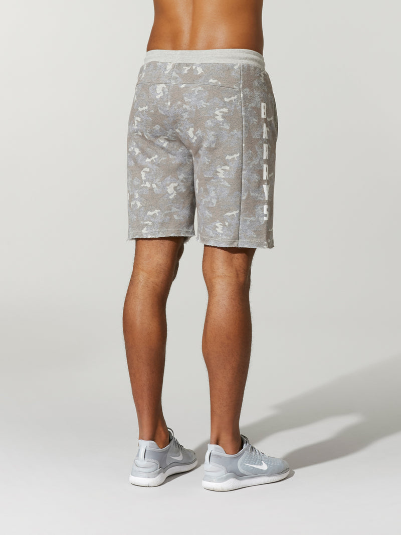 back view of shirtless male model in light grey camouflage printed shorts