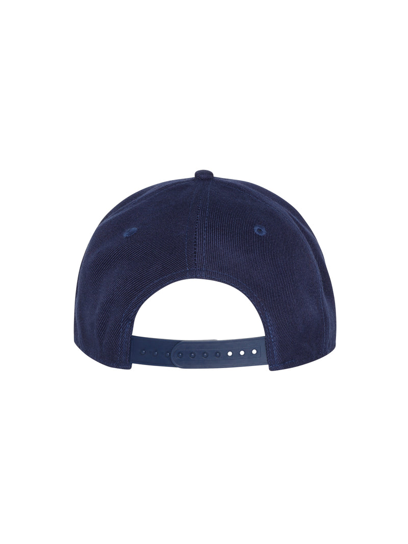 back view of navy blue flat bill hat with barry's written in red and white on front