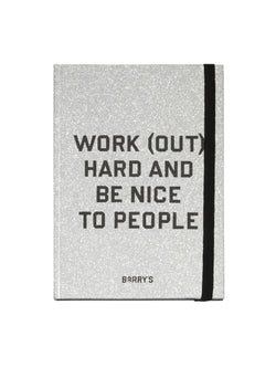 "silver glitter notebook with phrase ""work out hard and be nice to people"" written on cover"