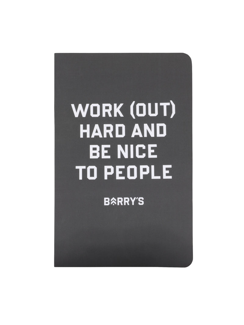 grey notebook with work out hard and be nice to people written on front