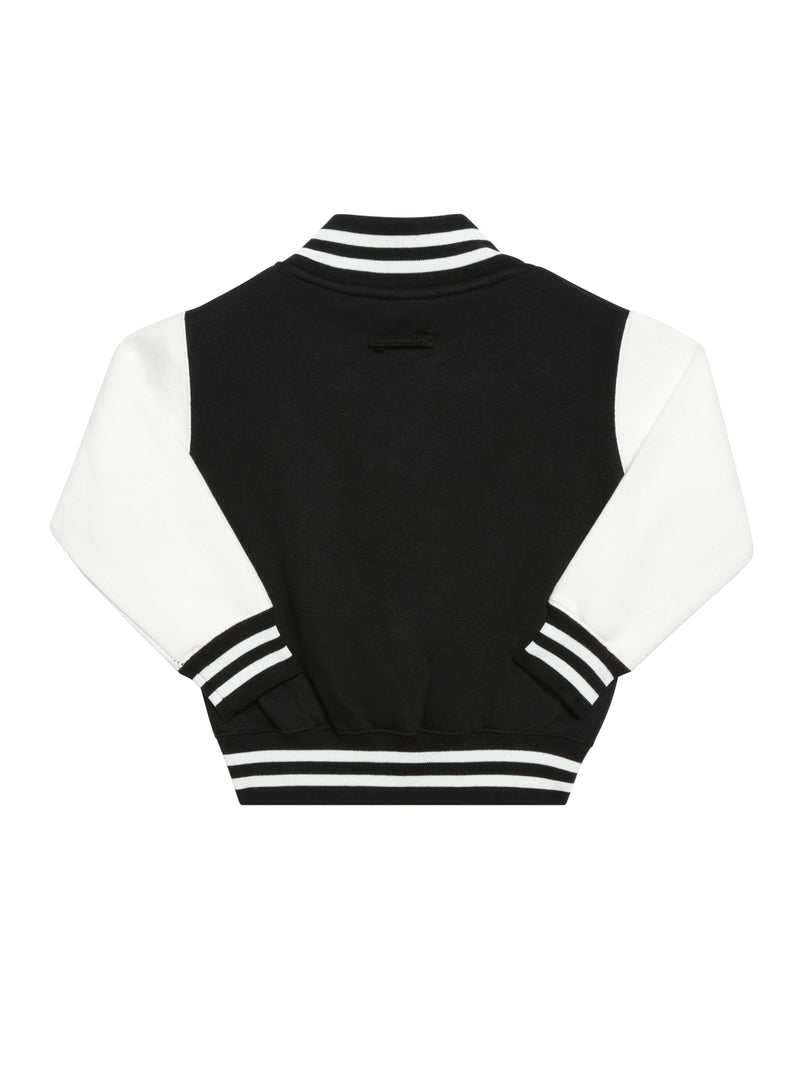 Back view of a baseball jacket with black chest, white sleeves and black and white striped wrist cuffs