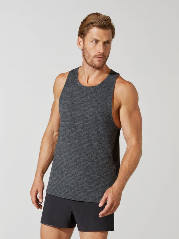 front view of male model in heather grey tank top and matching dark grey athletic shorts