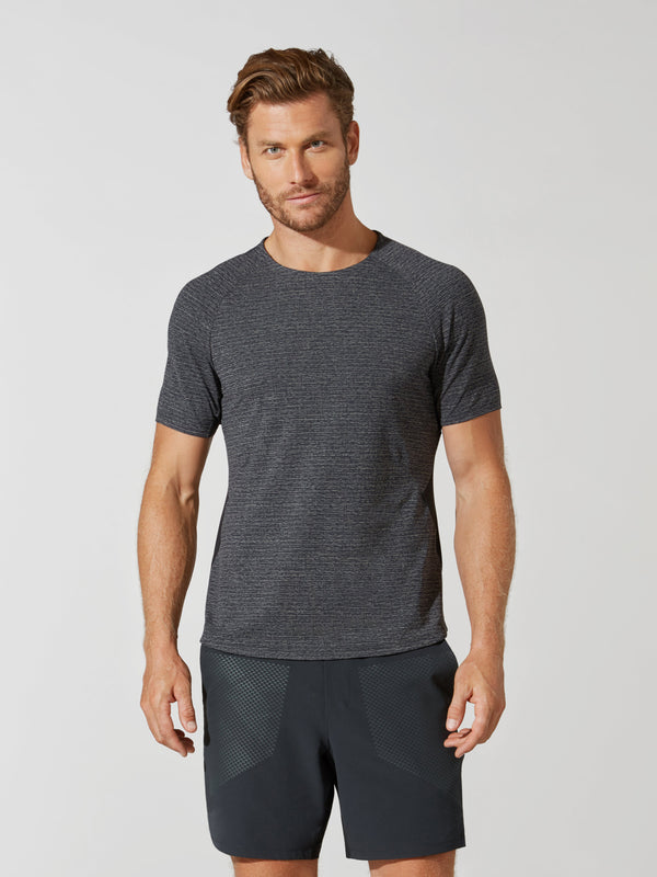 front view of male model in grey t-shirt and matching grey athletic shorts