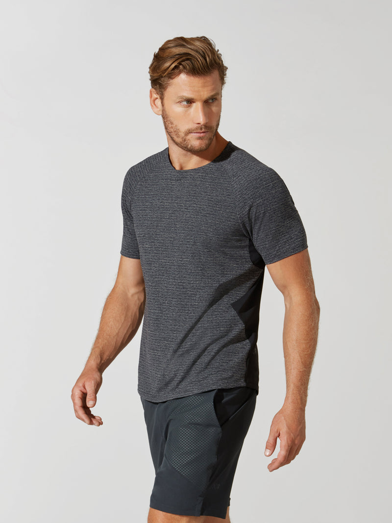 side view of male model in grey t-shirt and matching grey athletic shorts