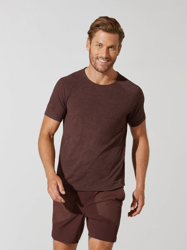 "front view of male model in maroon t-shirt with ""stronger as one"" written on side and matching athletic shorts"