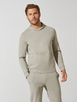 front view of male model in sand colored hooded sweatshirt and matching sweatpants