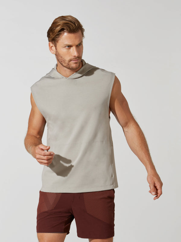front view of male model in sleeveless light grey hoodie and maroon athletic shorts