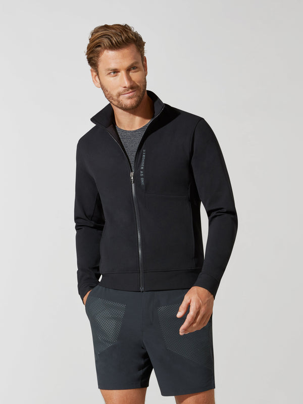 front view of male model in black zip up athletic jacket and dark grey shorts