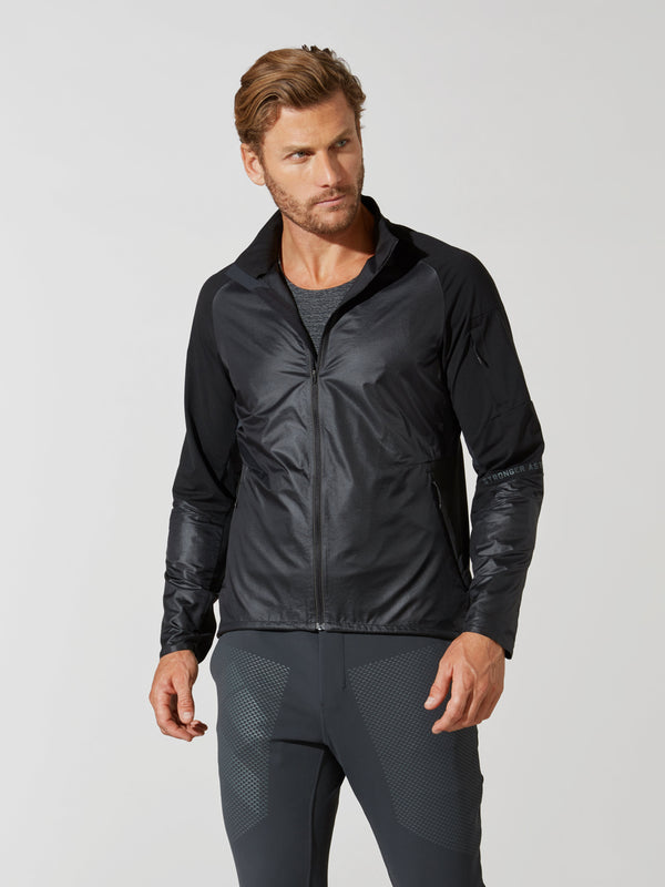 front view of male model in shiny black athletic jacket and dark grey athletic leggings