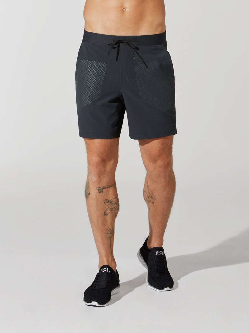 front view of male model in black athletic shorts and black sneakers