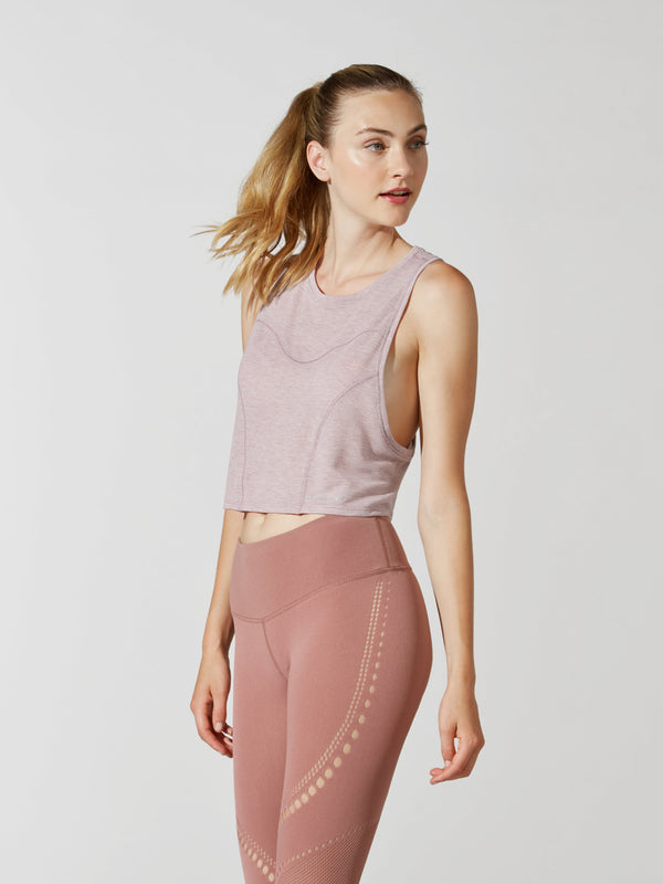 front view of female model in light pink cropped tank top and mauve leggings with mesh detailing
