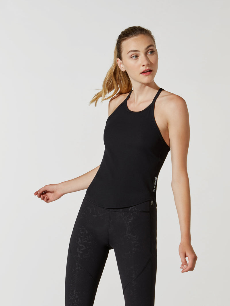 front view of female model in black cross back tank top and black leggings