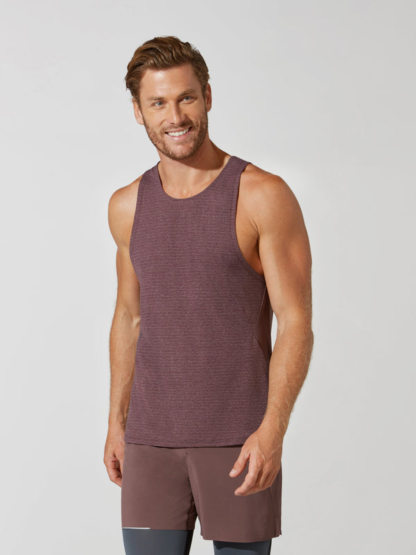 front view of male model in heather maroon tank top and matching athletic shorts