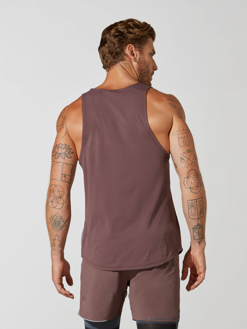 back view of male model in heather maroon tank top and matching athletic shorts