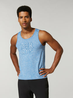 front view of male model in light blue tank top with Barry's written on chest and black shorts