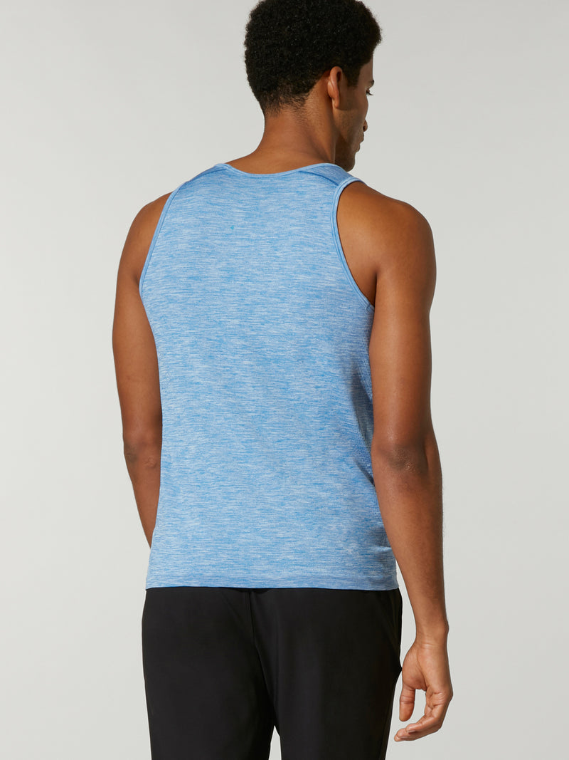 back view of male model in light blue tank top with Barry's written on chest and black shorts