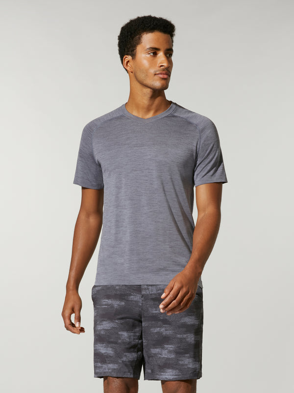 front view of male model in grey t-shirt and grey camouflage shorts