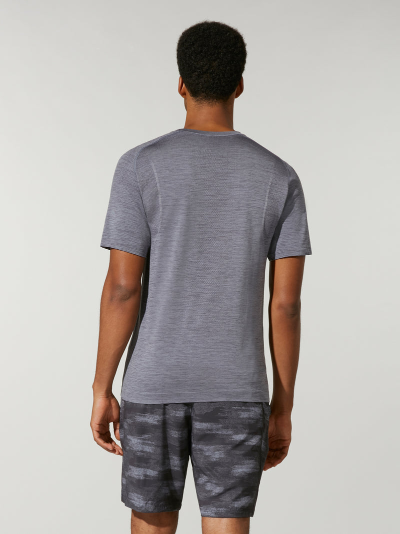 back view of male model in grey t-shirt and grey camouflage shorts