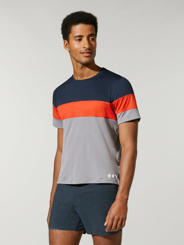front shot of model wearing Grey, Orange, and Navy wide striped FOURLAPS X BARRY'S SMASH TEE