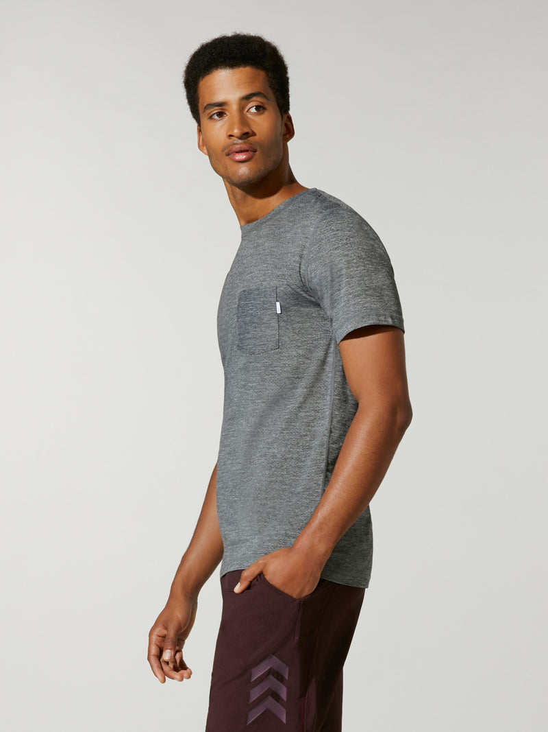 side view of male model in grey athletic t-shirt and black shorts